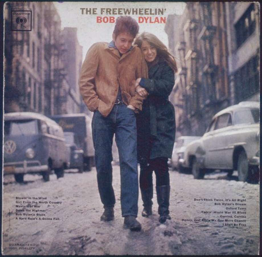 The cover for the Bob Dylan album 'The Freewheelin' Bob Dylan', released by Columbia Records in 1963. The cover features Dylan and his girlfriend Suze Rotolo walking near their apartment in Greenwich Village, New York City. (Blank Archives / Getty Images)