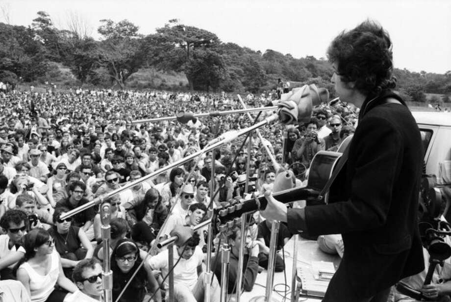 Singer/songwriter Bob Dylan performs at the Newport Folk Festival in July 1965 in Newport, Rhode Island. (David Gahr / Getty Images)