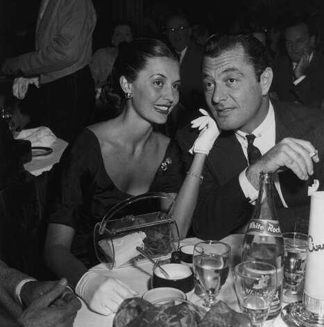 Married American actors Cyd Charisse and Tony Martin attending a dinner party, 1950s. (M. Garrett / Getty Images)