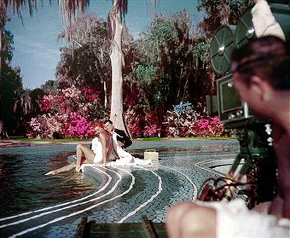 Aquatic film star Esther Williams and singer/actor Tony Martin perform during the filming of 'Easy To Love' at Cypress Gardens theme park in 1953 near Winterhaven, Florida. (Michael Ochs Archives / Getty Images)