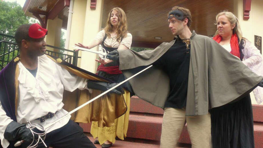 """The distressed lover Cardenio (David Rosenberg, right) defends his intended bride Luscinda (Noelle Fair, right) from the advances of his best friend Fernando (Michael Hagins, left) as Fernando's sometimes girlfriend Dorotea (Melissa Meli) tries to get her man back in Hudson Shakespeare Company's production of the """"lost"""" Shakespeare play """"Cardenio."""" The show will be presented on the grounds of the Stratford Library on Saturday, August 11. Photo: Contributed Photo"""