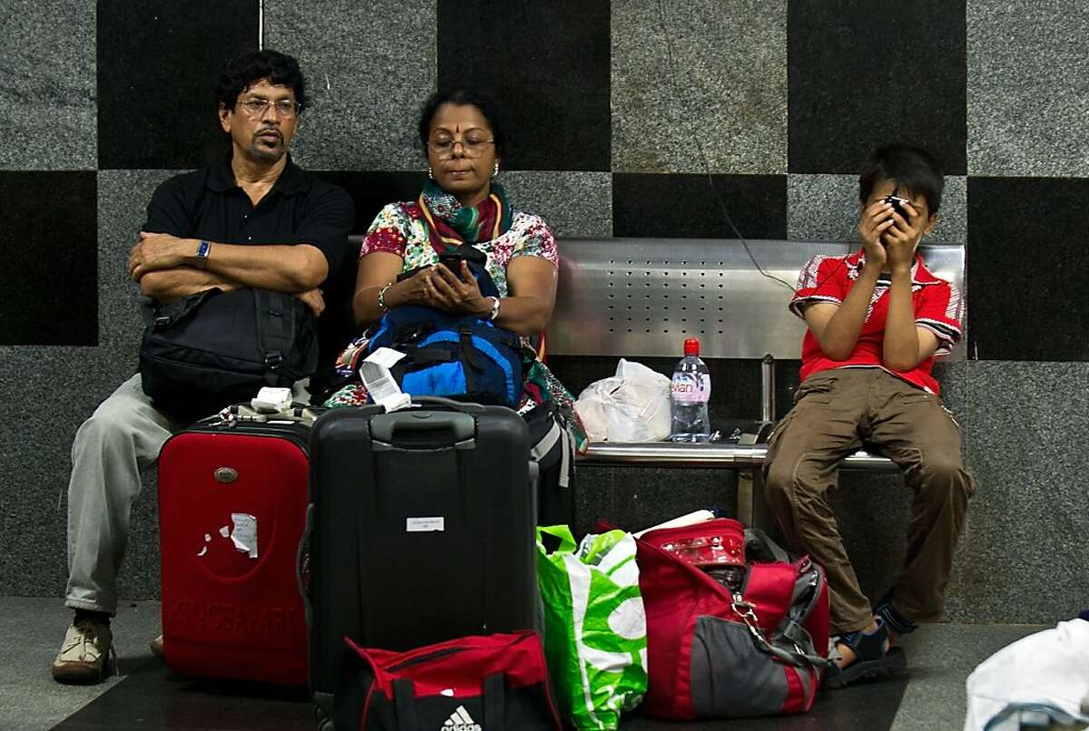 An Indian family waits for their train at a railway station following an overnight regionwide power outtage in New Delhi on July 30, 2012. A massive power cut blacked out a vast swathe of northern India July 30, leaving an estimated 300 million people without power in the worst outage in more than a decade, officials said. The cut severely disrupted transport networks, including trains and metro services, while traffic light systems also went down in some major cities causing snarls in the morning rush hour. AFP PHOTO / Prakash SINGHPRAKASH SINGH/AFP/GettyImages