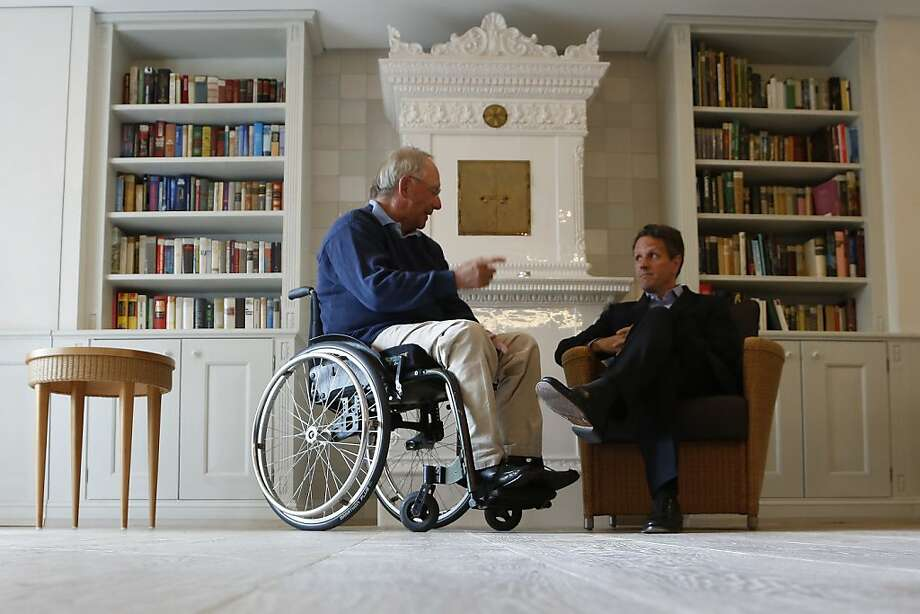 German Finance Minister Wolfgang Schaeuble, left, speaks with U.S. Treasury Secretary Timothy Geithner, right,  in the house where Schaeuble is vacationing, in Westerland on the German North Sea island of Sylt, Monday July 30, 2012. (AP Photo/dapd/ Philipp Guelland) Photo: Philipp Guelland, Associated Press