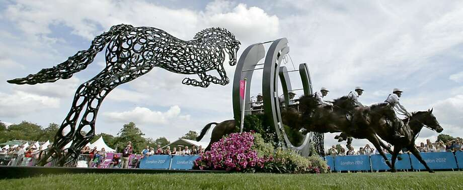 In this five frame multiple exposure, Andrew Hoy, of Australia, rides Rutherglen as he competes in the equestrian eventing cross-country stage at the 2012 Summer Olympics, Monday, July 30, 2012, in London. (AP Photo/Charlie Riedel) Photo: Charlie Riedel, Associated Press