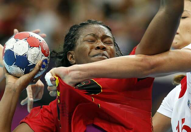 Marcelina Kiala of Angola, left, is challenged by Croatia's Andrea Penezic during their women's handball preliminary match at the 2012 Summer Olympics, Monday, July 30, 2012, in London. (AP Photo/Vadim Ghirda) Photo: Vadim Ghirda, Associated Press