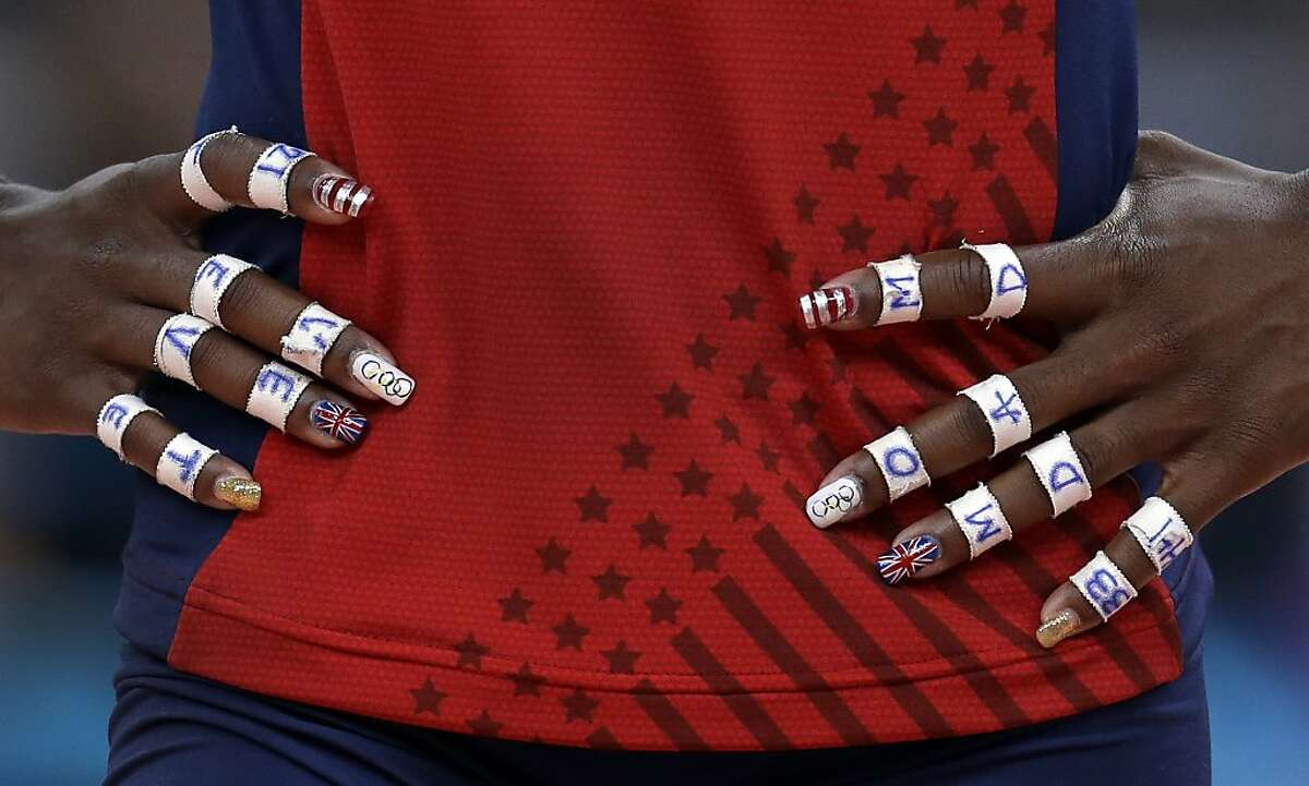 United States' Destinee Hooker rests her hand on her hips during a timeout in a women's preliminary volleyball match against Brazil at the 2012 Summer Olympics, Monday, July 30, 2012, in London. (AP Photo/Jeff Roberson)