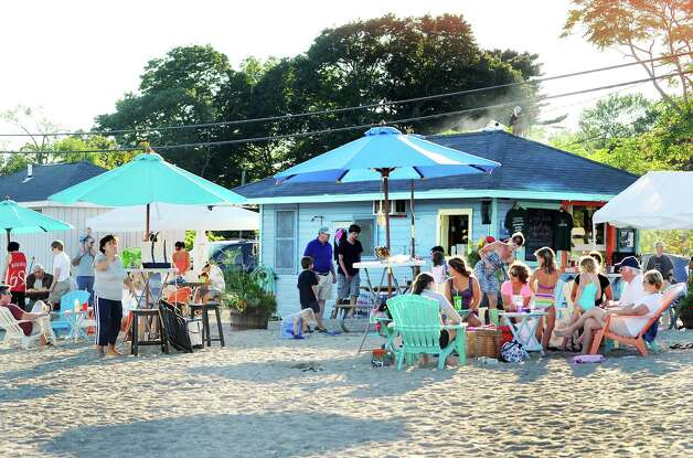 An evening crowd at King's Kitchen at Southport Beach in Southport, Conn. on Saturday July 21, 2012. Photo: Cathy Zuraw / Connecticut Post