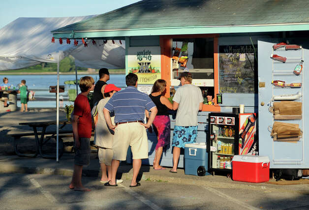 Customers line up to order dinner from King's Kitchen at Southport Beach in Southport, Conn. on Saturday July 21, 2012. Photo: Cathy Zuraw / Connecticut Post