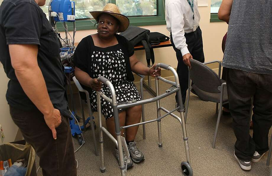 Pamela Hooks-Simmons (middle), 58 years old, from Oakland, getting instructions from physical therapist Jo Fox (left) at the Fall Prevention Clinic at Highland hospital in Oakland, Calif., as she gets a new walker on Monday, July 23, 2012.  The leading cause of injury-related hospital admissions for the elderly are falls.   State hospital data show nearly 73,000 people over age 60 were admitted to a hospital as a result of a fall within the past year. Photo: Liz Hafalia, The Chronicle