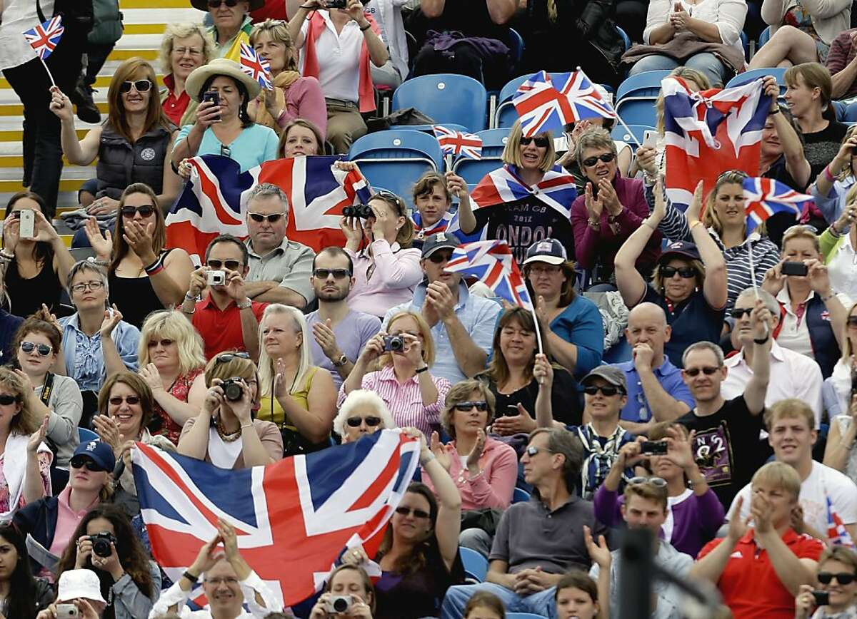 Spectators cheer as Zara Phillips, of Great Britain, competes with her horse High Kingdom, in the equestrian eventing dressage phase at the 2012 Summer Olympics, Sunday, July 29, 2012, in London. (AP Photo/David Goldman)
