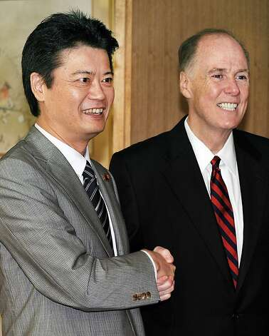 US National Security Advisor Tom Donilon (R) is welcomed by Japanese Foreign Minister Koichiro Gemba (L) prior to their talks at the Foreign Ministry in Tokyo on July 26, 2012. Donilon will meet with Japanese leaders and officials including Prime Minister Yoshihiko Noda during his stay in Japan.   AFP PHOTO / Toru YAMANAKATORU YAMANAKA/AFP/GettyImages Photo: Toru Yamanaka, AFP/Getty Images