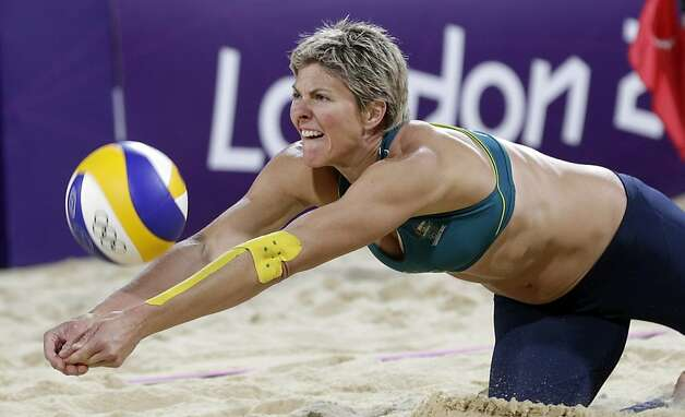 Nat Cook of Australia digs out a ball in a contest against Austria during a beach volleyball match at the 2012 Summer Olympics, Monday, July 30, 2012, in London. (AP Photo/Dave Martin) Photo: Dave Martin, Associated Press