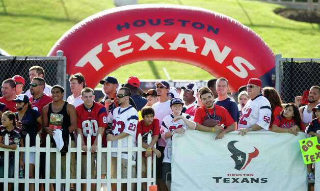 Houston Texans fans line up to watch practice during Texans training camp at the Methodist Training Center Monday, July 30, 2012, in Houston.  ( Brett Coomer / Houston Chronicle ) Photo: Brett Coomer, Staff / © 2012 Houston Chronicle
