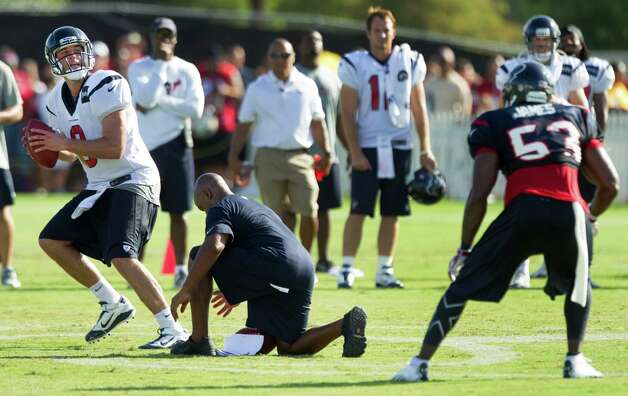 Houston Texans quarterback Matt Schaub (8) drops back to pass during a 7-on-7 drill as linebacker Bradie James (53) drops into coverage during Texans training camp at the Methodist Training Center Monday, July 30, 2012, in Houston.  ( Brett Coomer / Houston Chronicle ) Photo: Brett Coomer, Staff / © 2012 Houston Chronicle