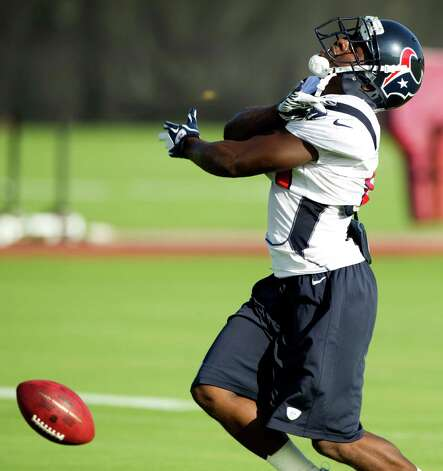 Houston Texans wide receiver Trindon Holliday reacts after dropping a pass during Texans training camp at the Methodist Training Center Monday, July 30, 2012, in Houston.  ( Brett Coomer / Houston Chronicle ) Photo: Brett Coomer, Staff / © 2012 Houston Chronicle