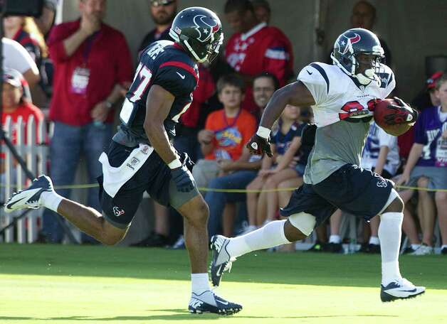 Houston Texans running back Justin Forsett (28) runs past safety Quintin Demps (27) during Texans training camp at the Methodist Training Center Monday, July 30, 2012, in Houston.  ( Brett Coomer / Houston Chronicle ) Photo: Brett Coomer, Staff / © 2012 Houston Chronicle
