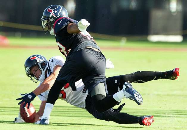 Houston Texans wide receiver Kevin Walter (83) dives for a ball knocked down by safety Torri Williams during Texans training camp at the Methodist Training Center Monday, July 30, 2012, in Houston.  ( Brett Coomer / Houston Chronicle ) Photo: Brett Coomer, Staff / © 2012 Houston Chronicle