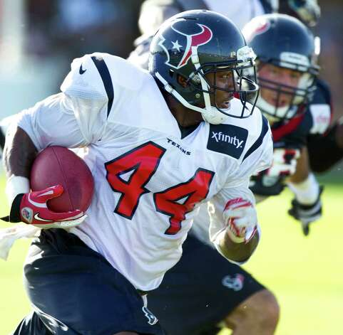 Houston Texans running back Ben Tate (44) runs with the ball during Texans training camp at the Methodist Training Center Monday, July 30, 2012, in Houston.  ( Brett Coomer / Houston Chronicle ) Photo: Brett Coomer, Staff / © 2012 Houston Chronicle