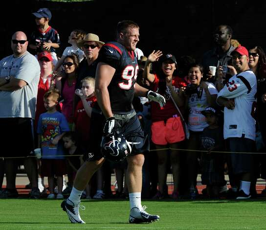 Houston Texans' J.J. Watt (99) is cheered by fans at training camp Monday, July 30, 2012, in Houston. (AP Photo/Pat Sullivan) Photo: Pat Sullivan, STF / AP