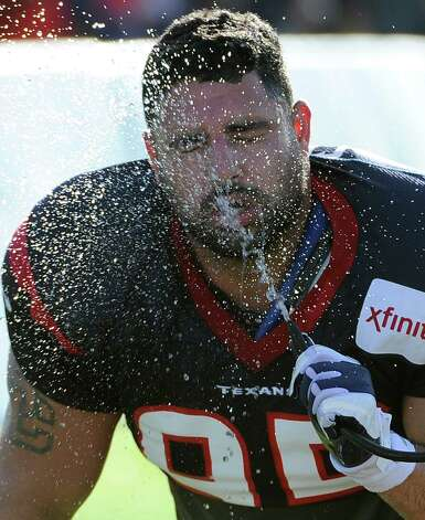 Houston Texans' Logan Brock beats the summer heat with a cold spray of water during training camp Monday, July 30, 2012, in Houston. (AP Photo/Pat Sullivan) Photo: Pat Sullivan, STF / AP