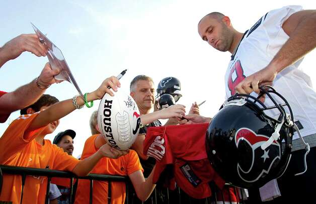 Houston Texans quarterback Matt Schaub signs autographs before practice during Texans training camp at the Methodist Training Center Saturday, July 28, 2012, in Houston.  ( Brett Coomer / Houston Chronicle ) Photo: Brett Coomer, Staff / © 2012 Houston Chronicle