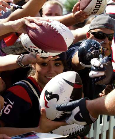Houston Texans fans wait for players to sign autographs following practice at Texans training camp at the Methodist Training Center Sunday, July 29, 2012, in Houston.  ( Brett Coomer / Houston Chronicle ) Photo: Brett Coomer, Staff / © 2012 Houston Chronicle