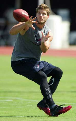Houston Texans wide receiver Kevin Walter looks back to make a catch during Texans training camp at the Methodist Training Center Sunday, July 29, 2012, in Houston.  ( Brett Coomer / Houston Chronicle ) Photo: Brett Coomer, Staff / © 2012 Houston Chronicle