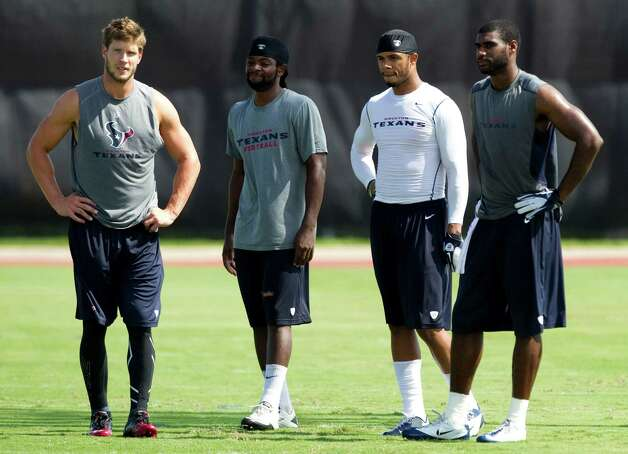 Houston Texans wide receivers Kevin Walter, from left, Keshawn Martin, DeVier Posey and Lestar Jean stand together at the end of practice during Texans training camp at the Methodist Training Center Sunday, July 29, 2012, in Houston.  ( Brett Coomer / Houston Chronicle ) Photo: Brett Coomer, Staff / © 2012 Houston Chronicle