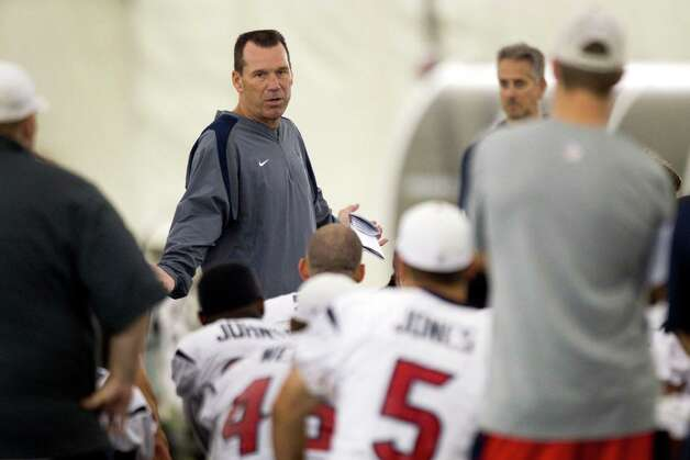 Houston Texans head coach Gary Kubiak talks to his players at the end of practice during Texans training camp at the Methodist Training Center Sunday, July 29, 2012, in Houston.  ( Brett Coomer / Houston Chronicle ) Photo: Brett Coomer, Staff / © 2012 Houston Chronicle