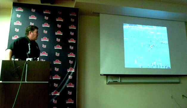 Lamar Cardinals Football Coach, Ray Woodard shows video clips of  recruits for the 2012 season at Lamar in Beaumont, Wednesday, February 1st, 2012. Tammy McKinley/The Enterprise Photo: TAMMY MCKINLEY