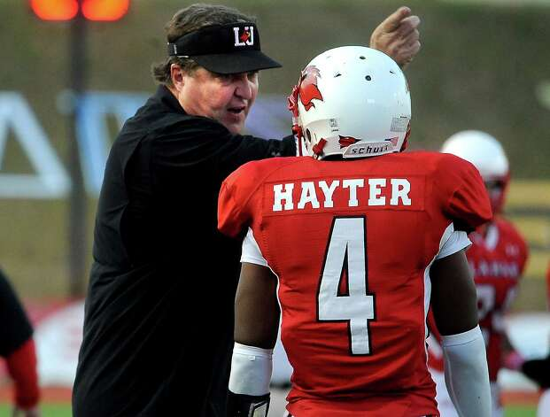 Lamar coach, Ray Woodard offers a friendly word of advise to Tim Hayter during the game against Stephen F. Austin at the Provost Umphrey Stadium at Lamar University in Beaumont, Saturday, November 5, 2011. Tammy McKinley/The Enterprise Photo: TAMMY MCKINLEY