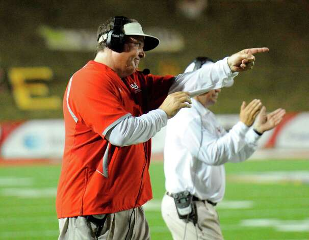 Cardinals head football coach Ray Woodard instructs a player from the sidelines during the first half against Incarnate Word at Provost Umphrey Stadium Saturday, September 17, 2011. Valentino Mauricio/The Enterprise Photo: Valentino Mauricio
