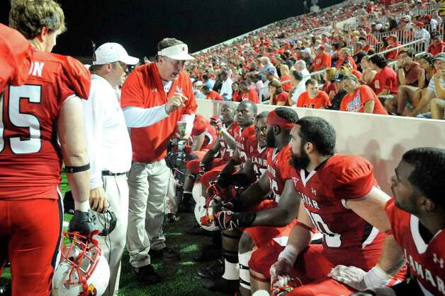 Cardinals head football coach Ray Woodard, center, talks with his players during the first half against Incarnate Word at Provost Umphrey Stadium Saturday, September 17, 2011. Valentino Mauricio/The Enterprise Photo: Valentino Mauricio