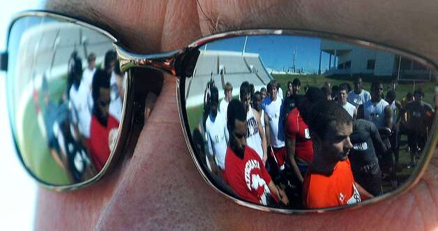 Lamar's head football coach, Ray Woodard, looks over several Cardinals while addressing them after student tryouts at Provost Umphrey Stadium on Monday. Guiseppe Barranco/The Enterprise / Beaumont