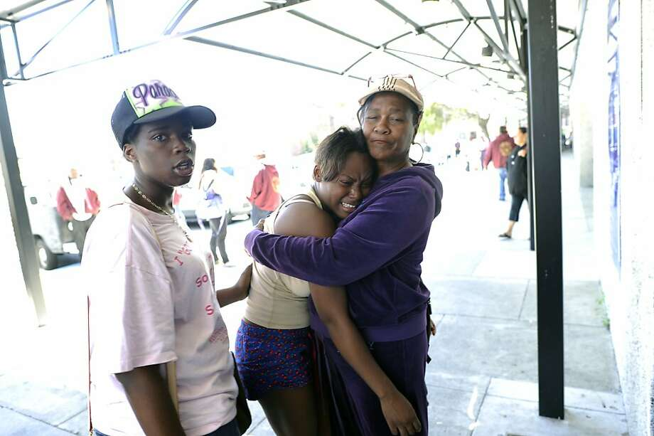 A grieving woman is comforted outside San Francisco General Hospital. Photo: Michael Short, Special To The Chronicle