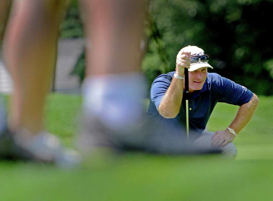 Frank Bensel of Norwalk lines up a put on the 2nd hole green hole at the 78th Connecticut Open golf Championship played at Wee Burn Country Club, Darien, CT on Monday July 30th, 2012 Photo: Mark Conrad / Stamford Advocate Freelance