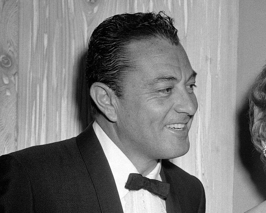 CORRECT SPELLING OF FRIARS CLUB - FILE - This Feb. 14, 1957 file photo shows singer Tony Martin at testimonial dinner given Jack Benny by the Friars Club in the Hollywood section of Los Angeles. Martin, the romantic singer who appeared in movie musicals from the 1930s to the 1950s and sustained a career in records, television and nightclubs from the Depression era into the 21st century, died of natural causes Friday, July 27, 2012, at his West Los Angeles home, his friend and accountant Beverly Scott said Monday. He was 98. Photo: AP