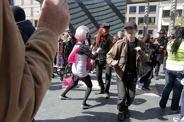 Occupy San Francisco protesters dance at a rally at Union Square in San Francisco, Calif., on Sunday, April 1, 2012. Following the rally, the group marched up Geary Street and took over a building at the corner of Turk and Gough Streets. Photo: Carlos Avila Gonzalez, The Chronicle