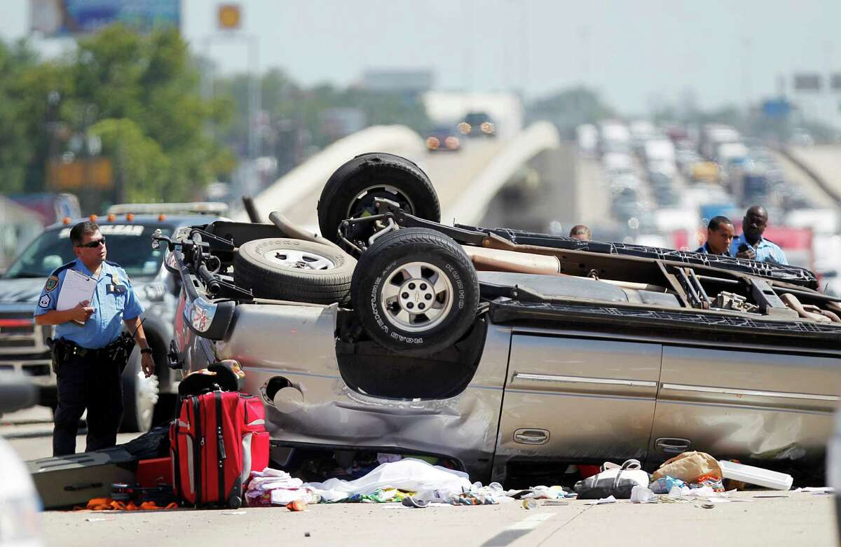 Houston Police investigate a fatal accident on northbound Highway 59 at Parker Road on Monday, July 30, 2012, in Houston.