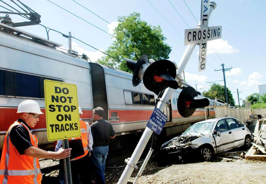 One of the cars hit by a Metro-North train at the railroad crossing on Riverbend Drive South in Stamford, Conn. Staff file photo Photo: ST