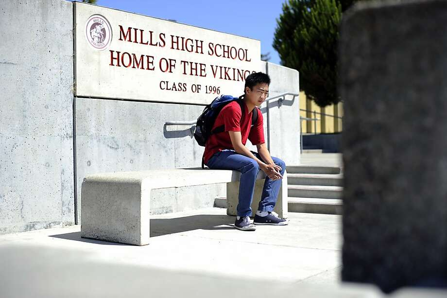 High school senior Leland Lam is seen at Mills High School in Millbrae, CA Monday July 30th, 2012. Leland Lam is one of several Chinese American students who have been denied admission to the school where their families live and have been reassigned to another,  lower-performing school nearby. Photo: Michael Short, Special To The Chronicle