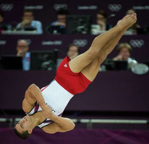Jake Dalton of the USA performs on floor exercise during the men's gymnastics team final at the 2012 London Olympics on Monday, July 30, 2012. The USA finished in 5th place. Photo: Smiley N. Pool, Houston Chronicle / © 2012  Houston Chronicle