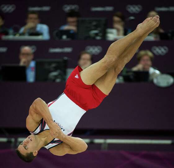 Jake Dalton of the USA performs on floor exercise during the men's gymnastics team final at the 2012