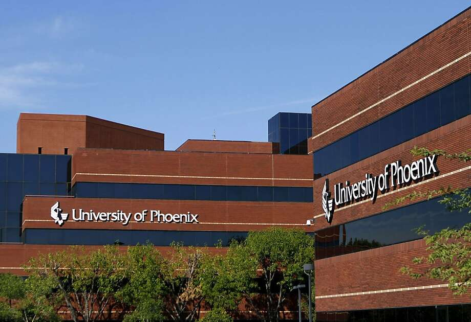 The main building of the University of Phoenix, part of Apollo Group Inc., is seen in Phoenix, Arizona, U.S., on Thursday, Oct. 14, 2010. Apollo Group, the biggest U.S.for-profit college by enrollment, led education shares to their biggest plunge in more than 5 years today after executives described a bleak future for signing up new students. Photographer: Joshua Lott/Bloom Photo: Joshua Lott, Bloomberg