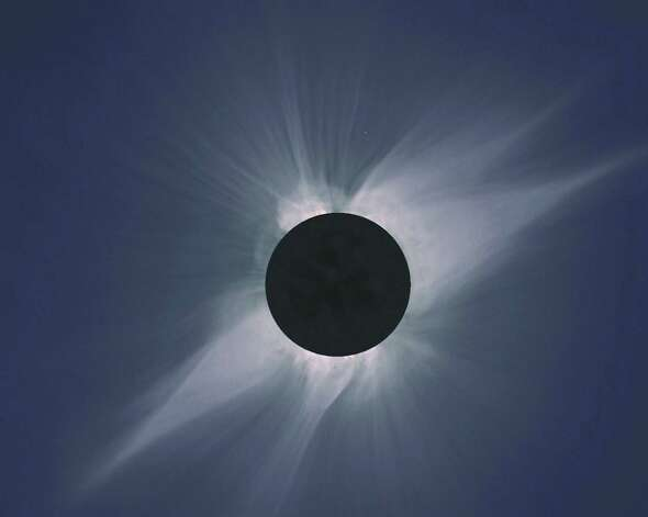 The ephemeral solar corona is too delicate to be captured by normal cameras, which is one reason photographs never convey the experience of watching a total solar eclipse.  This mosaic created by Steve Albers from five photographs of the 1991 total solar eclipse in Hawaii gives a better idea of what a total solar eclipse looks like to the naked eye.  (© Steve Albers – original photos by Dennis di Cicco and Gary Emerson)  [NOTE: April Orcutt has permission from Steve Albers to resell this mosaic to accompany her story about seeing a total solar eclipse.] Photo: Steve Albers, For The Express-News / © Steve Albers