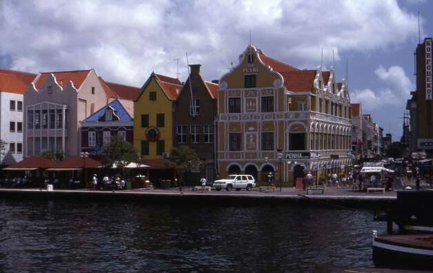 Dutch colonial buildings line the harbor in Willemstad, the capital of Curaçao. (© April Orcutt – all rights reserved) Photo: April Orcutt, For The Express-News / © April Orcutt -- all rights reserved