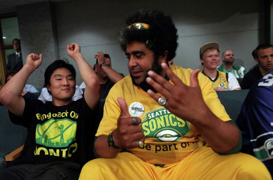 "Joseph Chong and Kris ""Sonics Guy"" Brannon react as King County Councilman Larry Gossett casts his vote supporting a new arena during a meeting of the King County Council on Monday, July 30, 2012 at Metropolitan King County Council chambers. Photo: JOSHUA TRUJILLO / SEATTLEPI.COM"