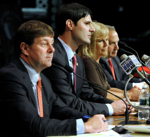 The four Republican candidates for the 5th Congressional District, debate Monday evening, July 30, 2012. They are from left, Andrew Roraback, Justin Bernier, Lisa Wilson-Foley and Mark Greenberg. The debate, held at Brookfield High School, was sponsored by the Brookfield Town Committee. Photo: Carol Kaliff