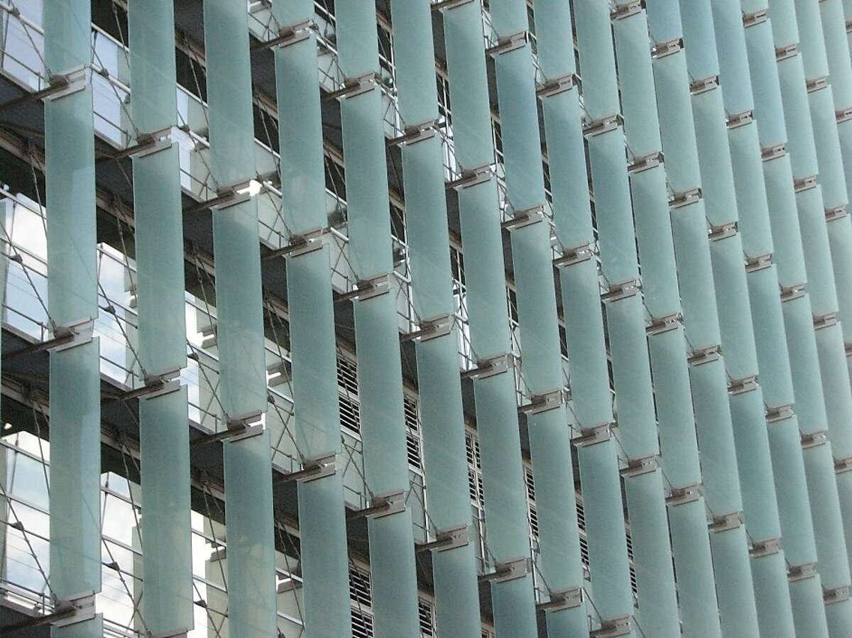 The San Francisco Federal Building, designed by Thom Mayne, makes dramatic architectural use of glass sun shades on the tower's northwest facade.