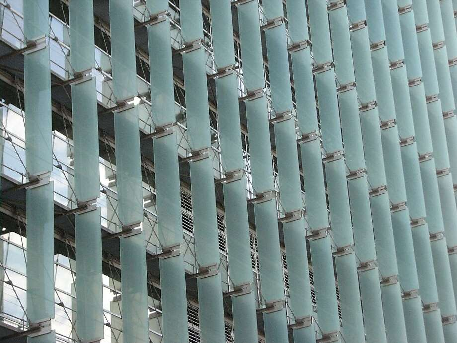The San Francisco Federal Building, designed by Thom Mayne, makes dramatic architectural use of glass sun shades on the tower's northwest facade. Photo: John King
